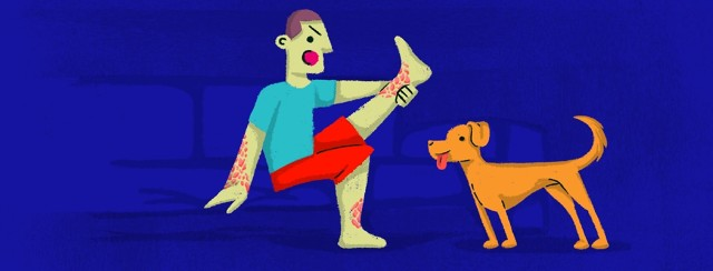Man holding up leg and yelling at dog while the dog looks on eagerly with his tongue out wanting to lick the plaque.
