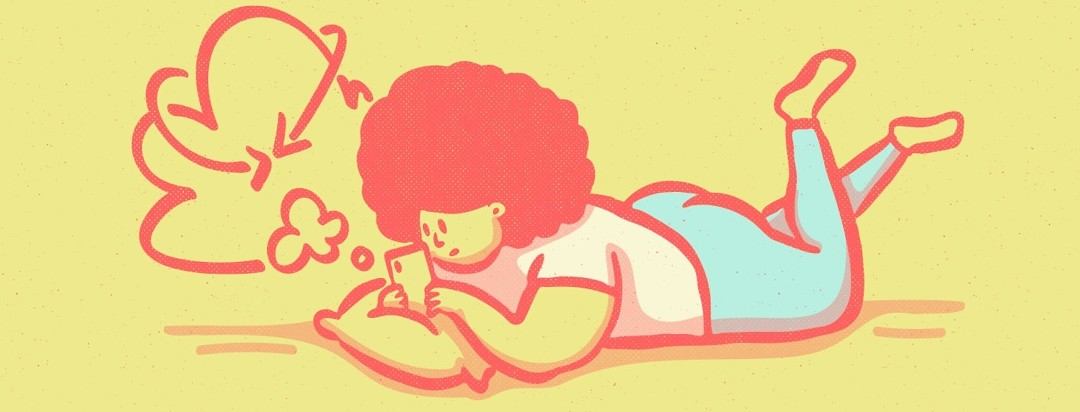 Woman lying on stomach researching on phone