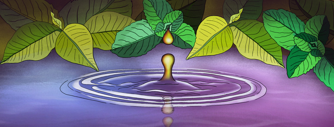 Oil dropping into colorful water surrounded by leaves