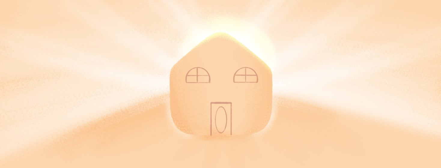 A house with light emanating from within it.