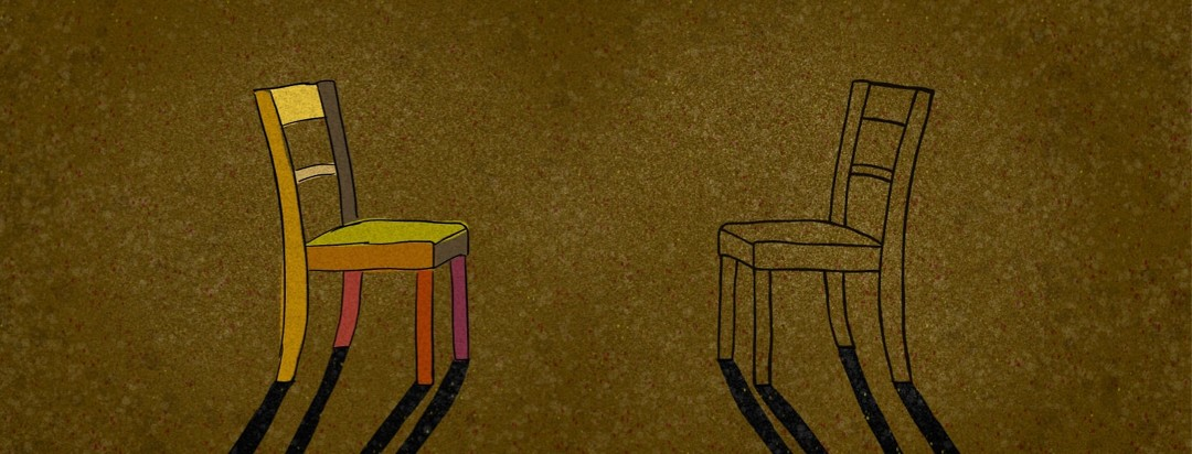 2 chairs facing each other; one colored and one transparent.