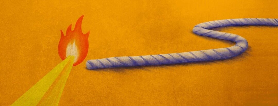 A match getting ready to ignite a string.