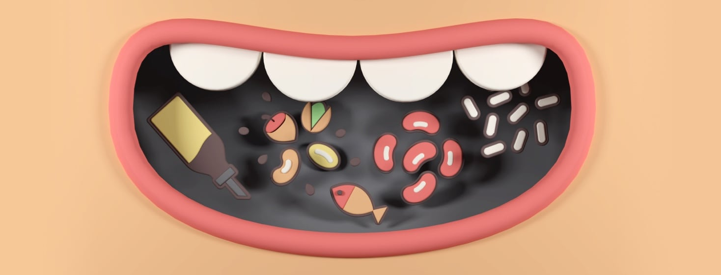 An open mouth with a variety of anti-inflammatory foods inside of it.